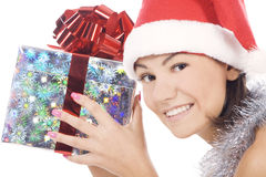 Sankt-Frau, die das Geschenk trägt Sankt-Hut zeigt. Stockbilder