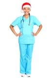 Sankt-Hut der Krankenschwester tragender Weihnachts Lizenzfreie Stockbilder