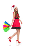 Sankt-Mädchen, das mit Einkaufstaschen geht Stockbilder