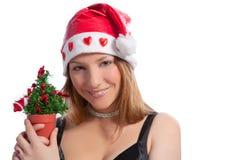 Sankt-Mädchen im roten Hutholding-Weihnachtsbaum Lizenzfreie Stockbilder