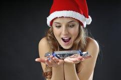 Sankt-Mädchen mit Weihnachtssüßigkeit lizenzfreie stockfotografie