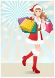 Sankt-Mädchenholdingpapiertüten. Weihnachtseinkaufen Stockbilder