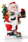 Sankt mit den Glocken, die Geschenke carring sind. Getrennt Lizenzfreies Stockbild
