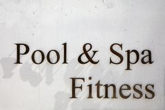 Pool, spa and fitness sign in metal letters on concrete texture background stock image