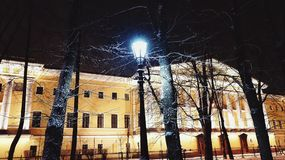 Sankt-Petersburg architecture building streetlight trees night outdoors city. Sky winter snow cold weather Stock Image