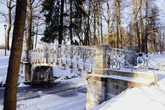 Sankt-Petersburg bridge cold day winter snow park trees outdoor stock photo