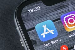 Apple store application icon on Apple iPhone X smartphone screen close-up. Mobile application icon of app store. Social network. A. Sankt-Petersburg, Russia Royalty Free Stock Image