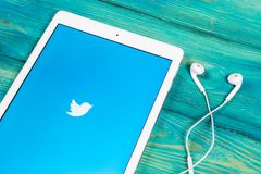 Twitter application icon on Apple iPad smartphone screen close-up. Twitter app icon. Social media icon. Social network. Sankt-Petersburg, Russia, April 1, 2018 Stock Image