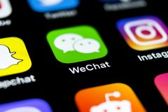 Wechat messenger application icon on Apple iPhone X smartphone screen close-up. Wechat messenger app icon. Social media network. Royalty Free Stock Photography