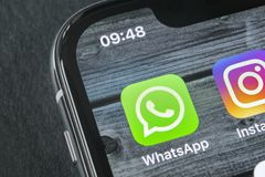 Whatsapp messenger application icon on Apple iPhone X smartphone screen close-up. Whatsapp messenger app icon. Social media icon. Sankt-Petersburg, Russia royalty free stock photos