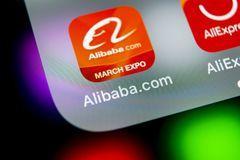 Alibaba application icon on Apple iPhone X smartphone screen close-up. Alibaba app icon. Alibaba.com is popular e-commerce applica. Sankt-Petersburg, Russia royalty free stock photography