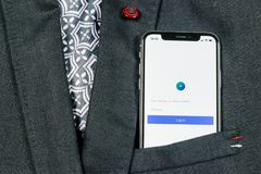 Facebook Ads application icon on Apple iPhone X screen close-up in jacket pocket. Facebook Business app icon. Facebook Ads mobile. Sankt-Petersburg, Russia stock photography