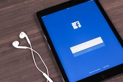 Apple iPad Pro with Facebook homepage on monitor screen. Facebook one of the biggest social network website. Homepage of Facebook. Stock Image