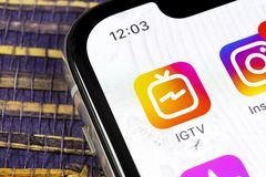 Apple iPhone X with social networking service IGTV Instagram on the smartphone screen close-up. IGTV app icon. Social media icon. Sankt-Petersburg, Russia royalty free stock photography
