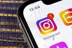 Instagram application icon on Apple iPhone X smartphone screen close-up. Instagram app icon. Social media icon. Social network. Sankt-Petersburg, Russia stock photography