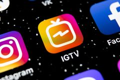Apple iPhone X with social networking service IGTV Instagram on the smartphone screen close-up. IGTV app icon. Social media icon. Sankt-Petersburg, Russia stock photos