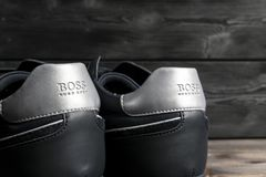 Boss Hugo Boss logo on the modern leather sport shoes. Hugo Boss is the brand of the Fashion creator. Sankt-Petersburg, Russia, February 6, 2018: Boss Hugo Boss stock image