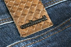 Cacharel logo on the modern leather sport jeans. Cacharel is the brand of the modern Fashion creator. Sankt-Petersburg, Russia, February 6, 2018: Cacharel logo royalty free stock image