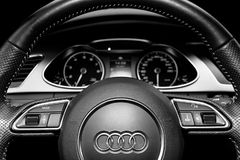 Close up of a Audi A4 S-line steering wheel. Modern car interior details. Speedometer, tachometer. Car dashboard. Black and white. Sankt-Petersburg, Russia royalty free stock photo