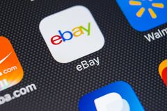 EBay application icon on Apple iPhone X screen close-up. eBay app icon. eBay.com is largest online auction and shopping websites. Sankt-Petersburg, Russia royalty free stock photo