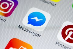 Facebook messenger application icon on Apple iPhone X screen close-up. Facebook messenger app icon. Online internet social media. Sankt-Petersburg, Russia stock photos
