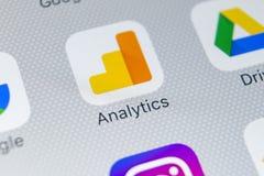 Google Analytics application icon on Apple iPhone X screen close-up. Google Analytics icon. Google Analytics application. Social. Sankt-Petersburg, Russia Royalty Free Stock Photography