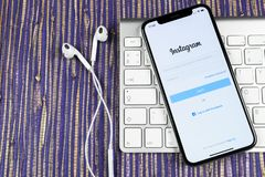 Instagram application icon on Apple iPhone X smartphone screen close-up. Instagram app icon. Social media icon. Social network. Sankt-Petersburg, Russia royalty free stock images