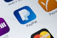 PayPal application icon on Apple iPhone X smartphone screen close-up. PayPal app icon. PayPal is an online electronic payment royalty free stock images