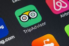 Tripadvisor application icon on Apple iPhone X screen close-up. Tripadvisor.com app icon. Tripadvisor is an online travel website.