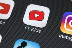 YouTube Kids application icon on Apple iPhone X screen close-up. Youtube Kids app icon. YouTube kids application. Social media net. Sankt-Petersburg, Russia royalty free stock image