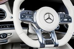 Dashboard and steering wheel with media control buttons of a Mercedes Benz S 63 AMG 4Matic V8 Bi-Turbo 2018. Car interior details. Sankt-Petersburg, Russia Royalty Free Stock Images