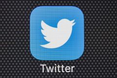 Twitter application icon on Apple iPhone 8 smartphone screen close-up. Twitter app icon. Twitter is an online social networking. Sankt-Petersburg, Russia Royalty Free Stock Image