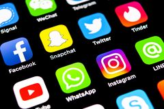 Apple iPhone X with icons of social media facebook, instagram, twitter, snapchat, google application on screen. Social media icons. Sankt-Petersburg, Russia royalty free stock images