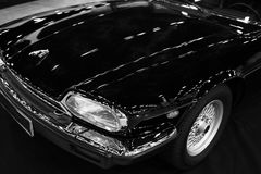 Front view of a Luxury car grand tourer Jaguar XJ-S Coupe. Black and white. Sankt-Petersburg, Russia, July 21 2017: Front view of a Luxury car grand tourer Royalty Free Stock Photography