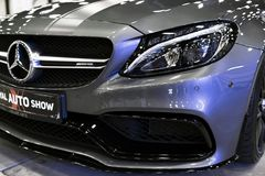 Front view of a Mercedes Benz C 63s AMG coupe 2017. Front Headlight. Dark Matt colour .Car exterior details. Royalty Free Stock Photography