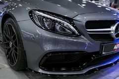 Front view of a Mercedes Benz C 63s AMG coupe 2017. Front Headlight. Dark Matt colour .Car exterior details. Stock Photography