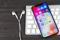 Apple iPhone X with icons of social media facebook, instagram, twitter, snapchat application on screen. Social media icons. Socia. Sankt-Petersburg, Russia, June stock images