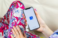 Google My Business application icon on Apple iPhone X screen in woman hands. Google My Business icon. Google My business applicati. Sankt-Petersburg, Russia royalty free stock images