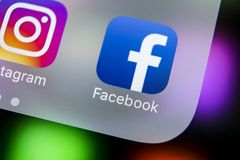 Facebook application icon on Apple iPhone X smartphone screen close-up. Facebook app icon. Social media icon. Social network. Sankt-Petersburg, Russia, March 21 Royalty Free Stock Photos