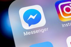 Facebook messenger application icon on Apple iPhone X screen close-up. Facebook messenger app icon. Online internet social media. Sankt-Petersburg, Russia, March stock photos