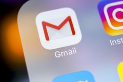 Google Gmail application icon on Apple iPhone X smartphone screen close-up. Gmail app icon. Gmail is popular Internet online e-ma. Sankt-Petersburg, Russia stock photo