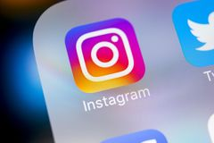 Instagram application icon on Apple iPhoneX smartphone screen close-up. Instagram app icon. Social media icon. Social network. Sankt-Petersburg, Russia, March 6 stock images