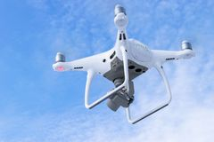 The New Aircraft DJI Phantom 4 pro quadcopter drone with 4K video camera and wireless remote controller flying in the sky. Aerial. Sankt-Petersburg, Russia royalty free stock photography