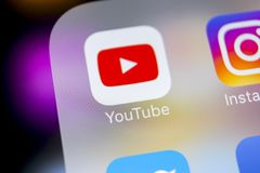 YouTube application icon on Apple iPhone X smartphone screen close-up. Youtube app icon. Social media icon. Social network stock photography