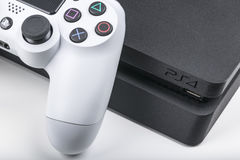 Sankt-Petersburg, Russia, May 20, 2017: Sony PlayStation 4 game console with a joystick dualshock 4 on white background. Home video game console taken in Royalty Free Stock Images