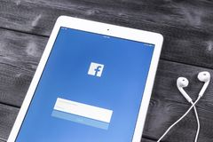 Apple iPad Pro with Facebook homepage on monitor screen. Facebook one of the biggest social network website. Homepage of Facebook. Stock Photos