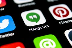 Google Hangouts application icon on Apple iPhone X smartphone screen close-up. Google hangouts app icon. Social network. Social me. Sankt-Petersburg, Russia stock photos
