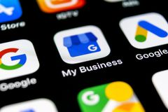 Google My Business application icon on Apple iPhone X screen close-up. Google My Business icon. Google My business application. S. Sankt-Petersburg, Russia stock image