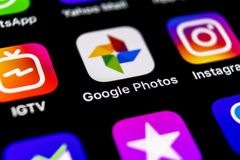 Google Photos plus application icon on Apple iPhone X screen close-up. Google plus Photos icon. Google photos application. Social. Sankt-Petersburg, Russia royalty free stock photography