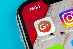Google plus application icon on Apple iPhone X smartphone screen close-up. Google plus app icon. Google . Social media icon. Socia. Sankt-Petersburg, Russia stock photography